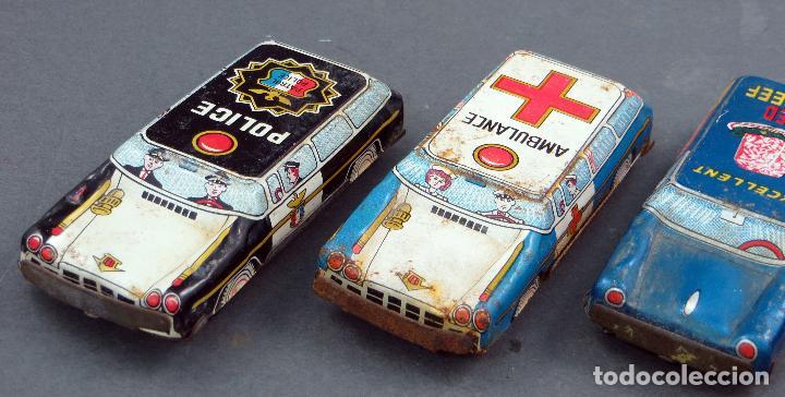 Juguetes antiguos de hojalata: 4 coches hojalata policía ambulancia y publicidad Made in Japan - Foto 2 - 118909167