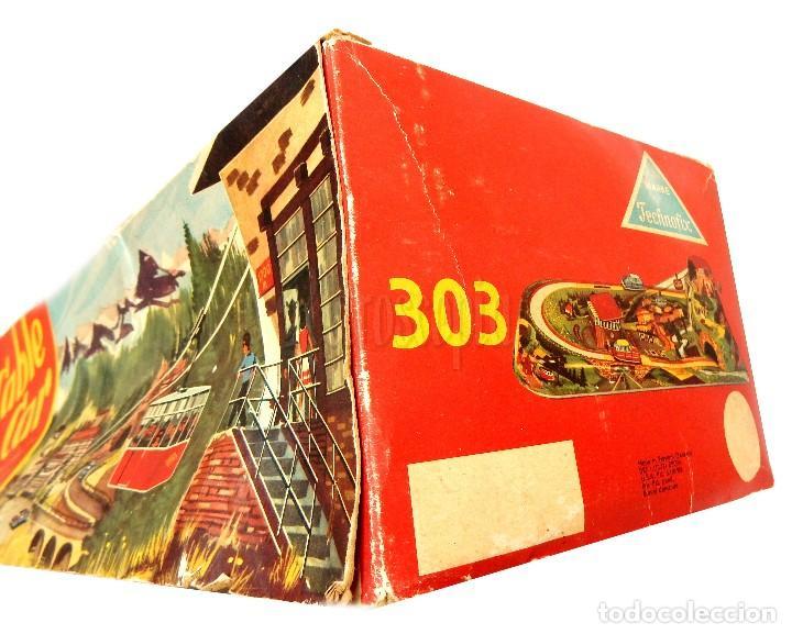 Juguetes antiguos de hojalata: PISTA ACCESORIOS MOVIBLES TELEFÉRICO CABLE CAR TECHNOFIX WESTERN GERMANY A CUERDA AÑOS 60 CON CAJA - Foto 20 - 128491283