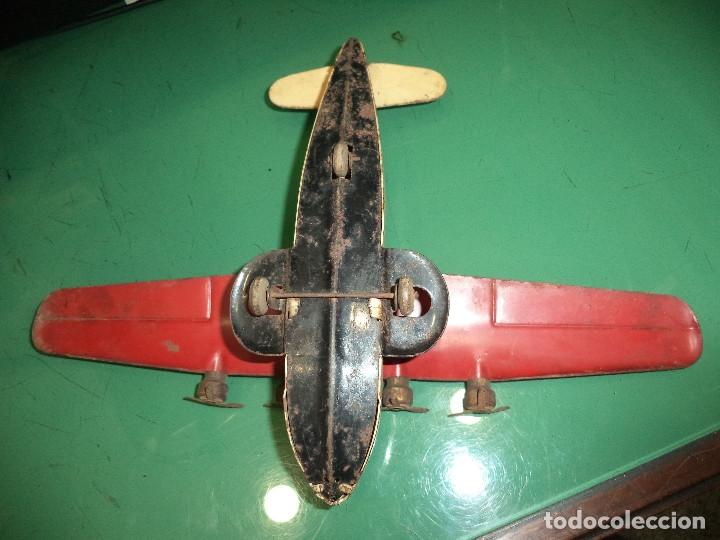 Juguetes antiguos de hojalata: AVION CON HELICES DE HOJALATA - Foto 6 - 128973079