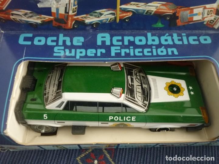 Juguetes antiguos de hojalata: COCHE ACROBATICO DE FRICCION ESTADO NUEVO - Foto 7 - 136210142