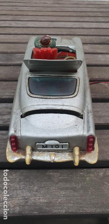 Juguetes antiguos de hojalata: RARO COCHE JAMES BOND 007 ASTON MARTIN DE HOJALATA (LATA) JAPONES CON MANDO , AÑOS 70 - Foto 7 - 140797914