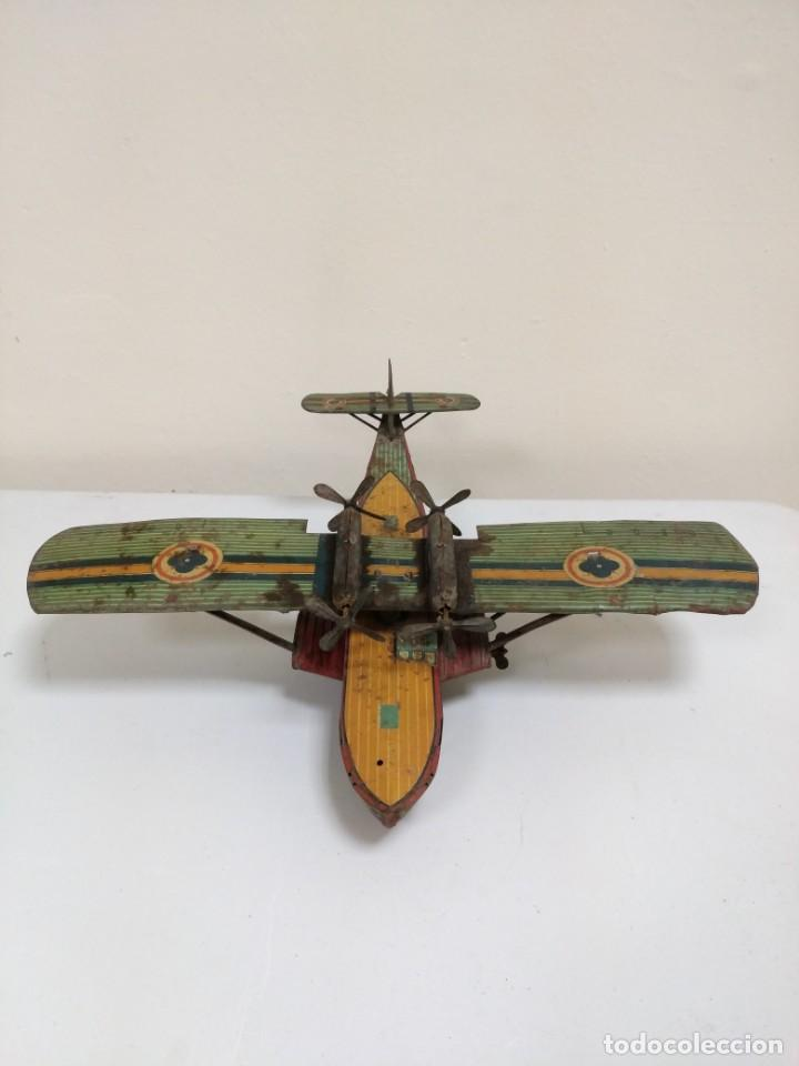 Juguetes antiguos de hojalata: Rarísimo Avion Garai Paya Hermanos 1936 litografiado - Foto 2 - 140902518