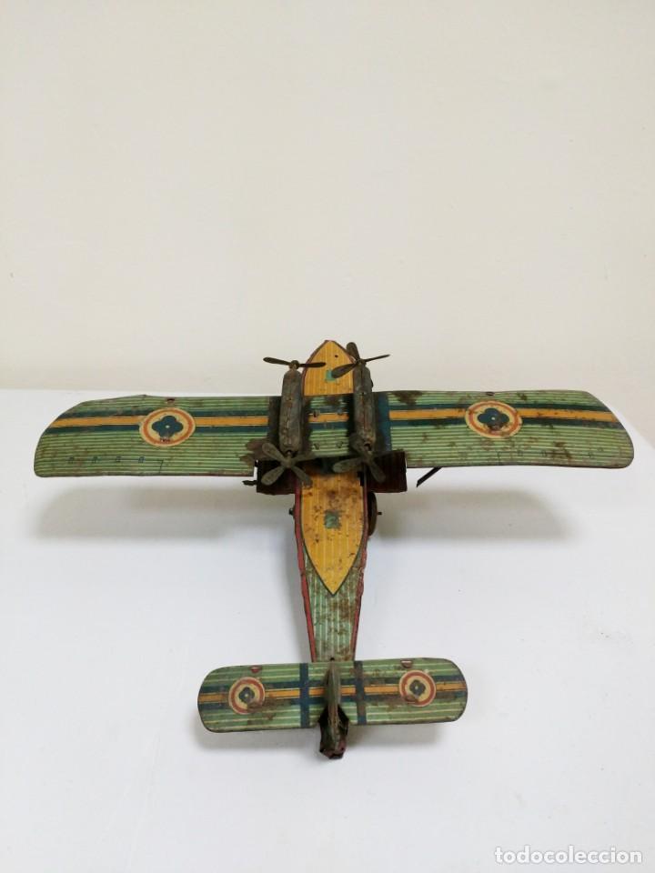 Juguetes antiguos de hojalata: Rarísimo Avion Garai Paya Hermanos 1936 litografiado - Foto 3 - 140902518