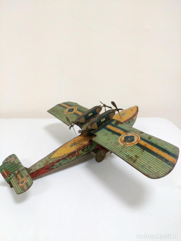 Juguetes antiguos de hojalata: Rarísimo Avion Garai Paya Hermanos 1936 litografiado - Foto 4 - 140902518