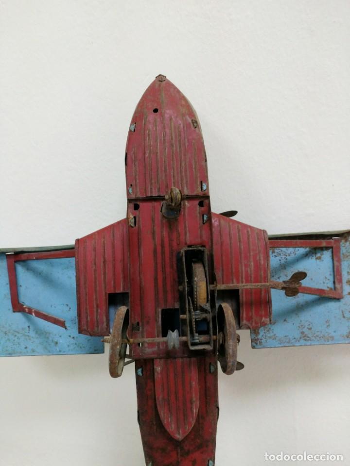 Juguetes antiguos de hojalata: Rarísimo Avion Garai Paya Hermanos 1936 litografiado - Foto 5 - 140902518