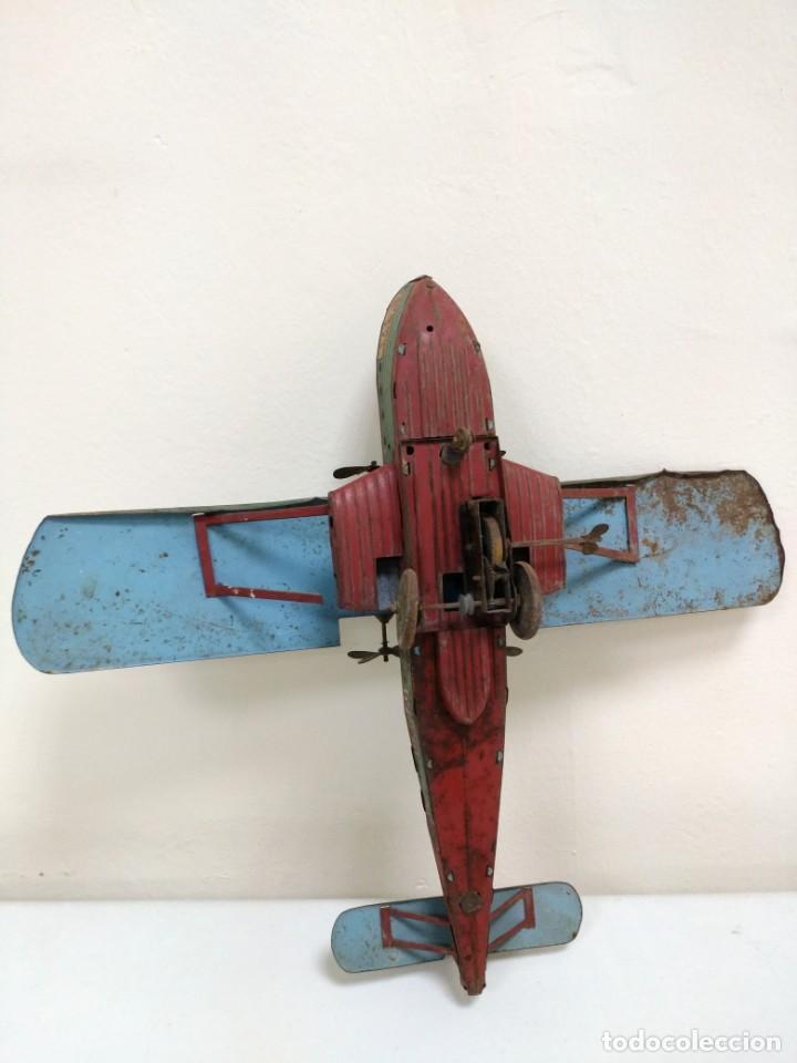 Juguetes antiguos de hojalata: Rarísimo Avion Garai Paya Hermanos 1936 litografiado - Foto 6 - 140902518