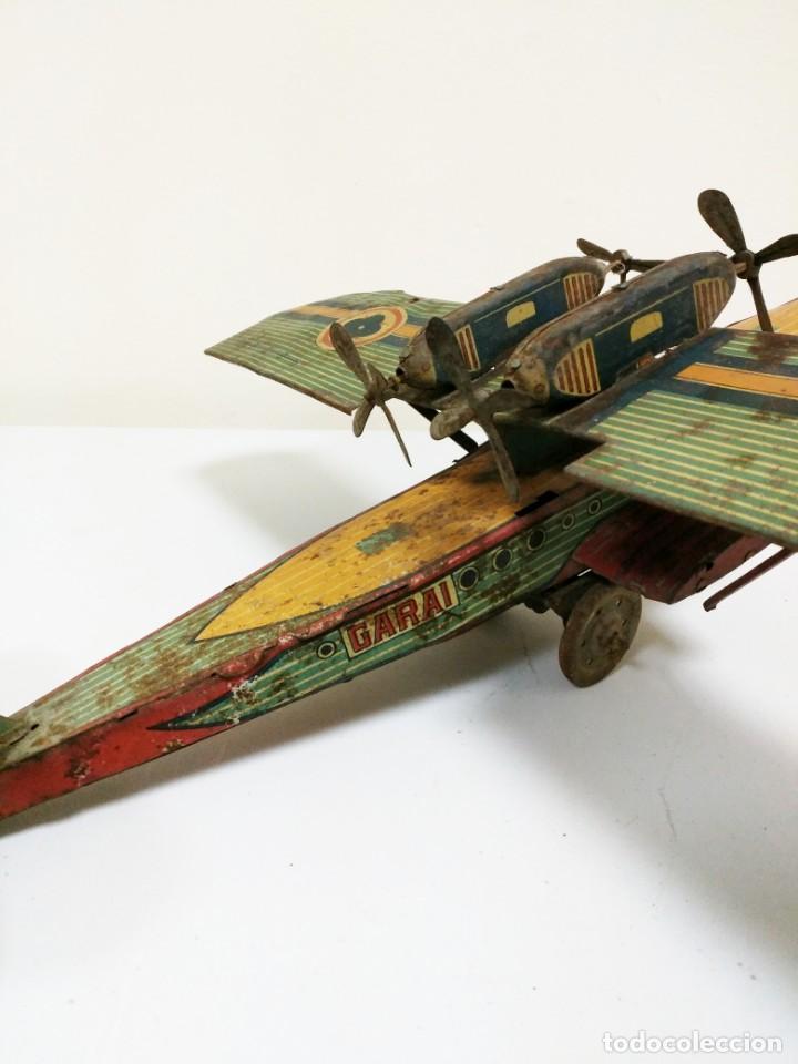 Juguetes antiguos de hojalata: Rarísimo Avion Garai Paya Hermanos 1936 litografiado - Foto 8 - 140902518
