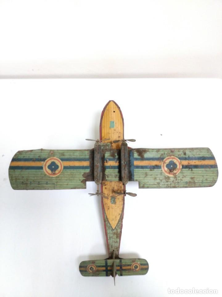 Juguetes antiguos de hojalata: Rarísimo Avion Garai Paya Hermanos 1936 litografiado - Foto 12 - 140902518