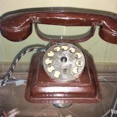Juguetes antiguos de hojalata: TELEFONO DE HOJALATA RICO. Lote 144554652