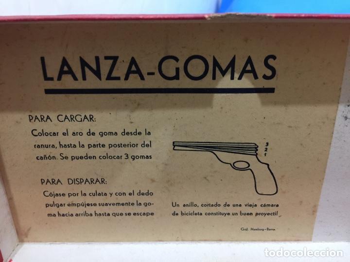Juguetes antiguos de hojalata: DALIA SOLIDO PISTOLA LANZAGOMAS 1935 - Foto 9 - 146442194
