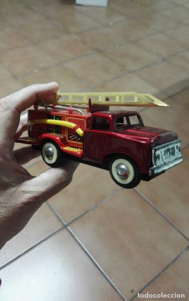 Juguetes antiguos de hojalata: Camión de bomberos hojalata antiguo - Foto 2 - 149704238