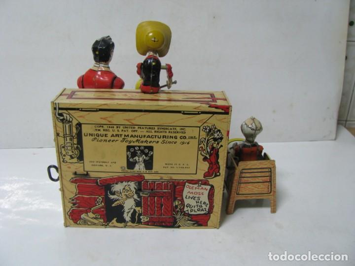 Juguetes antiguos de hojalata: 721-ANTIGUA BANDA DOGPATCH AL PIANO,LATA LITOGRAFIADA Y CUERDA DE UNIQUE ART,USA,AÑO 1940,EXCELE - Foto 3 - 150651150
