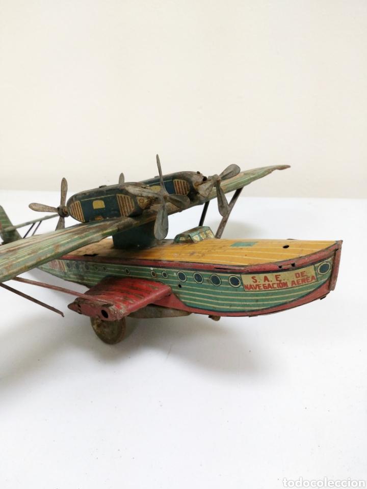 Juguetes antiguos de hojalata: Juguete Hidroavión litografía Hermanos Garai Payá 1936 - Foto 3 - 165909434
