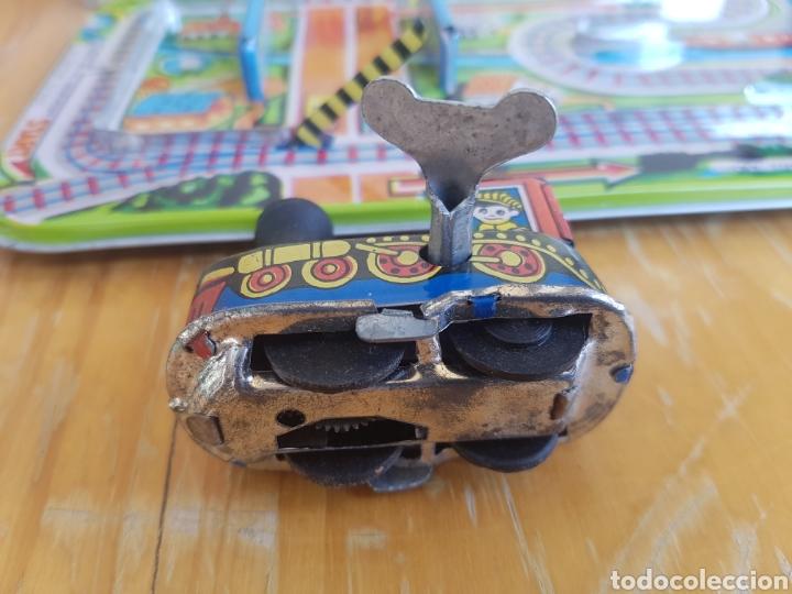 Juguetes antiguos de hojalata: Juguete de hojalata a cuerda LTI Magic Cross Road años 70 - Foto 4 - 170409041