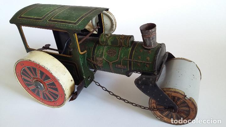 Juguetes antiguos de hojalata: APISONADORA, de fabricacion Alemana, de hojalata - Foto 3 - 194010812