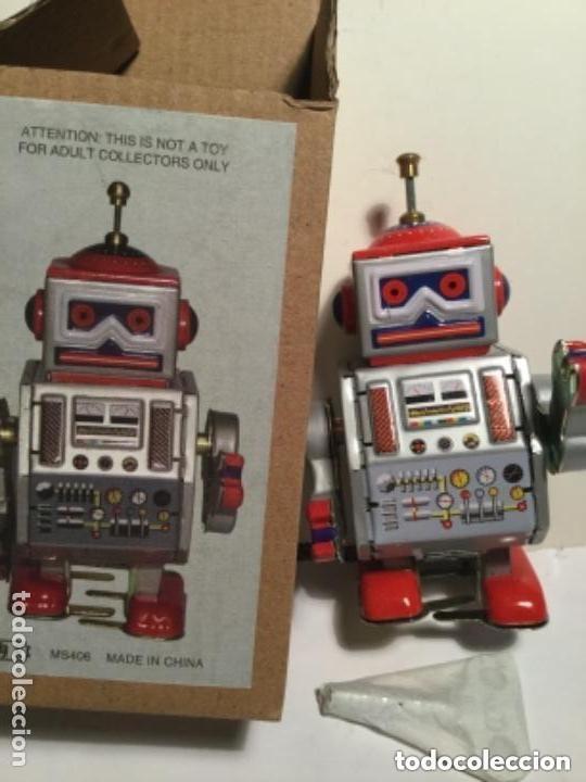 ROBOT - 10 CM. - CUERDA (Juguetes - Juguetes de Hojalata: Reproducciones y Actuales )