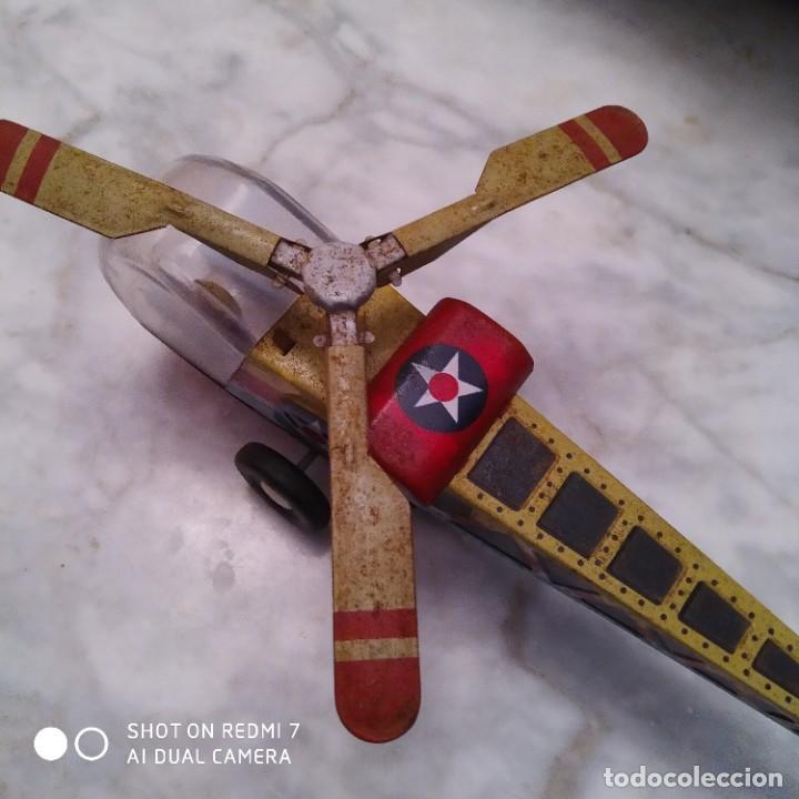 Juguetes antiguos de hojalata: Helicóptero hojalata friccion - Foto 5 - 194733071