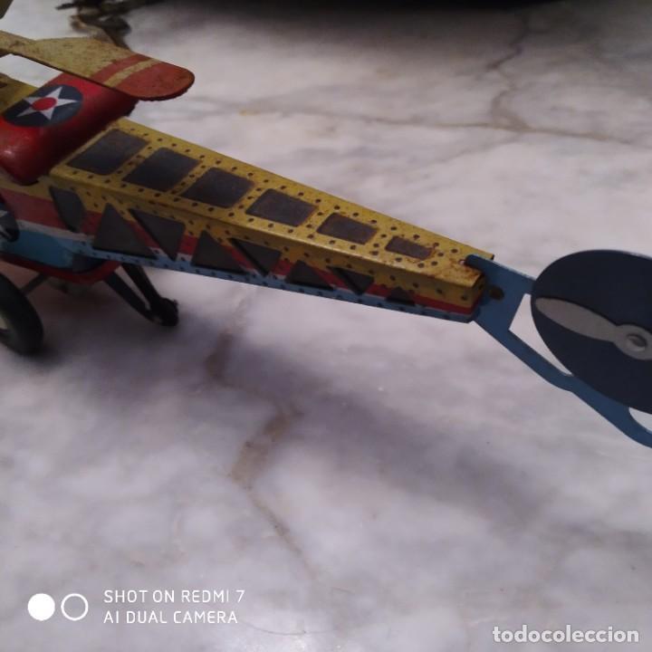 Juguetes antiguos de hojalata: Helicóptero hojalata friccion - Foto 6 - 194733071