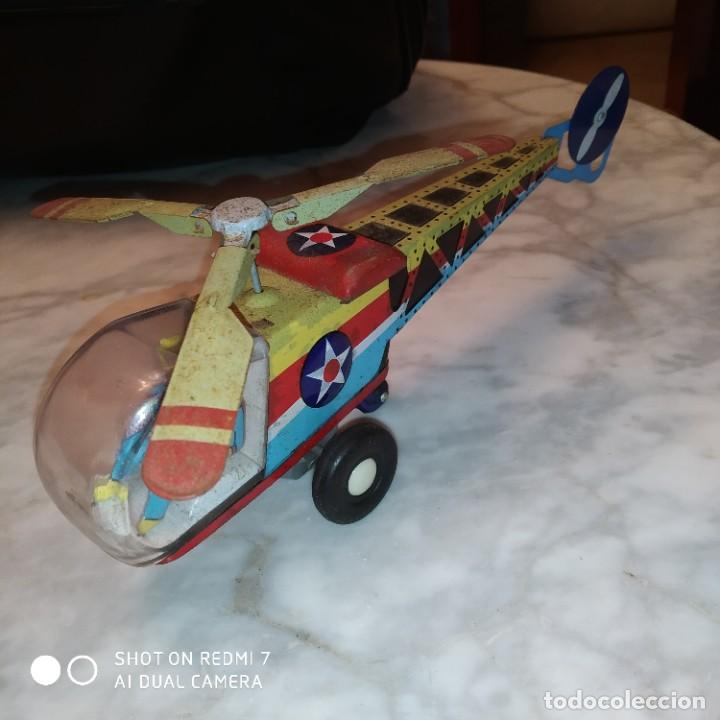 Juguetes antiguos de hojalata: Helicóptero hojalata friccion - Foto 7 - 194733071