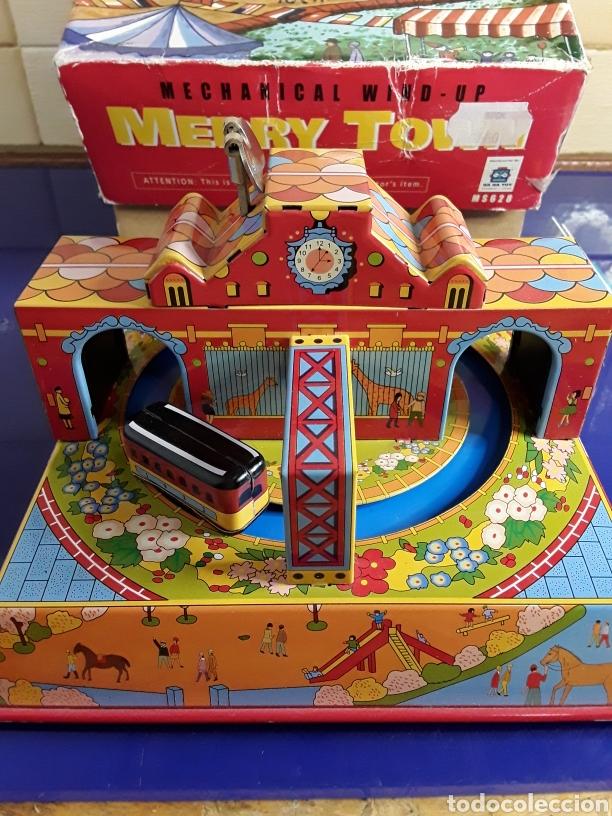 Juguetes antiguos de hojalata: Bonito juguete de cuerda y chapa en su caja original - Foto 2 - 199956153