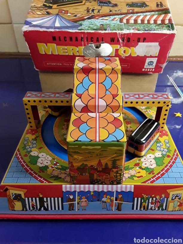 Juguetes antiguos de hojalata: Bonito juguete de cuerda y chapa en su caja original - Foto 3 - 199956153