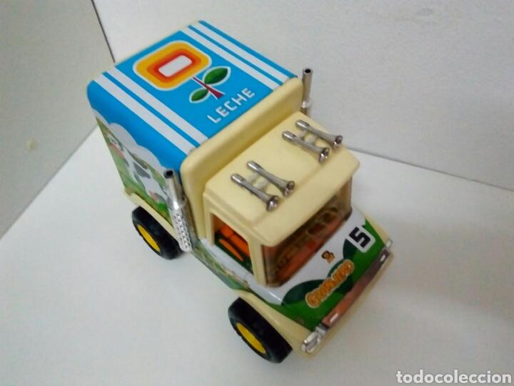 Juguetes antiguos de hojalata: Camion granjero leche obertoys - Foto 2 - 200307598