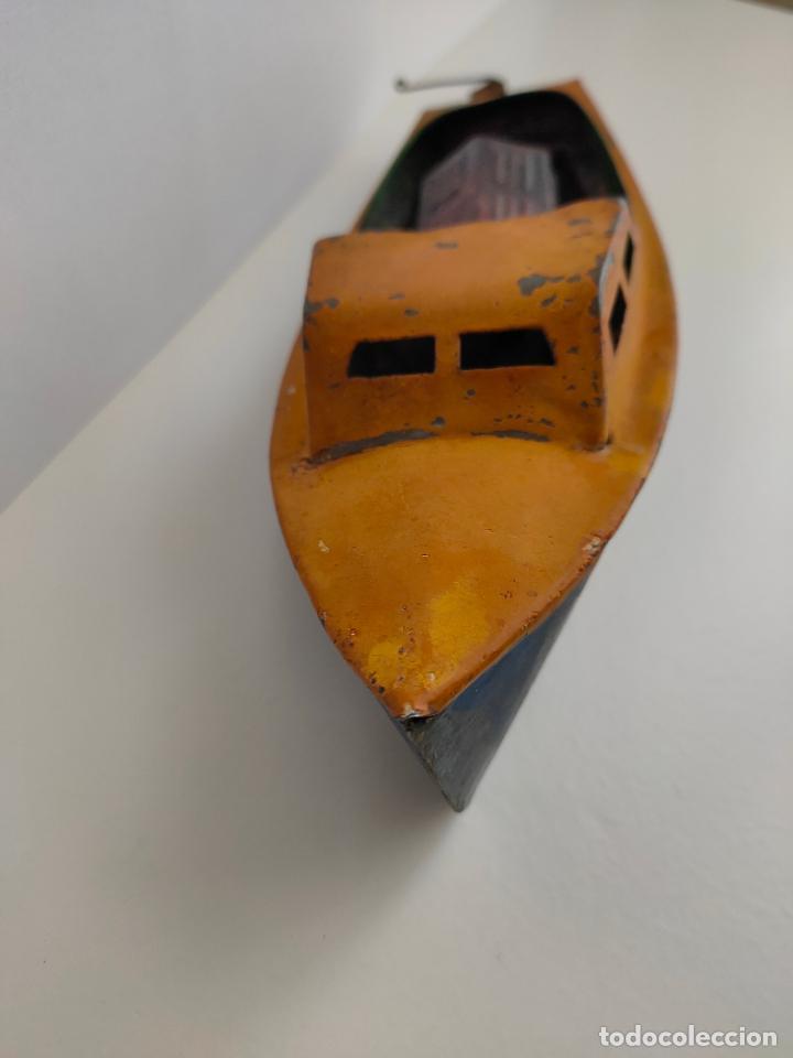 Juguetes antiguos de hojalata: Lancha o barca a vapor, posiblemente Hispania o Denia, años 20 o 30. Mide 22 x 7 x 5,5 cms. - Foto 12 - 205699062