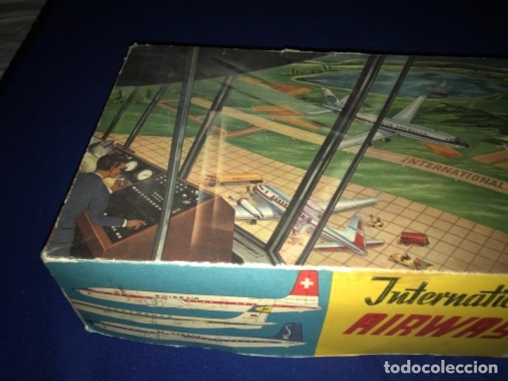 Juguetes antiguos de hojalata: International AIRWAYS - Technofix - Modelo 309 - Buen estado - Made in W Germany años 60 - Foto 38 - 210698091