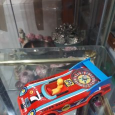 Juguetes antiguos de hojalata: ANTIGUO COCHE RULETA HOJALATA Y PVC MADE IN JAPAN SUPER DUNLOP NGK. Lote 263009880
