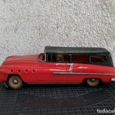 Juguetes antiguos de hojalata: COCHE HOJALATA MADE IN WESTERN GERMANY CONDUCTOR MITAD S XX 9X11X27CMS. Lote 293450003