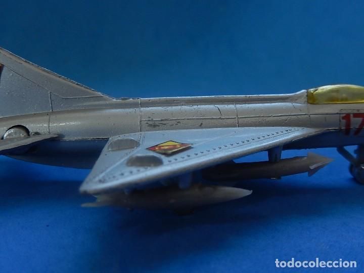 Modelos a escala: Pequeño avión. MIG-21. Fabricado en Hong Kong. - Foto 4 - 129673011