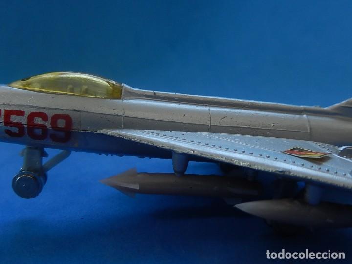 Modelos a escala: Pequeño avión. MIG-21. Fabricado en Hong Kong. - Foto 11 - 129673011