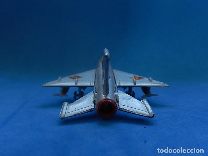 Modelos a escala: Pequeño avión. MIG-21. Fabricado en Hong Kong. - Foto 14 - 129673011