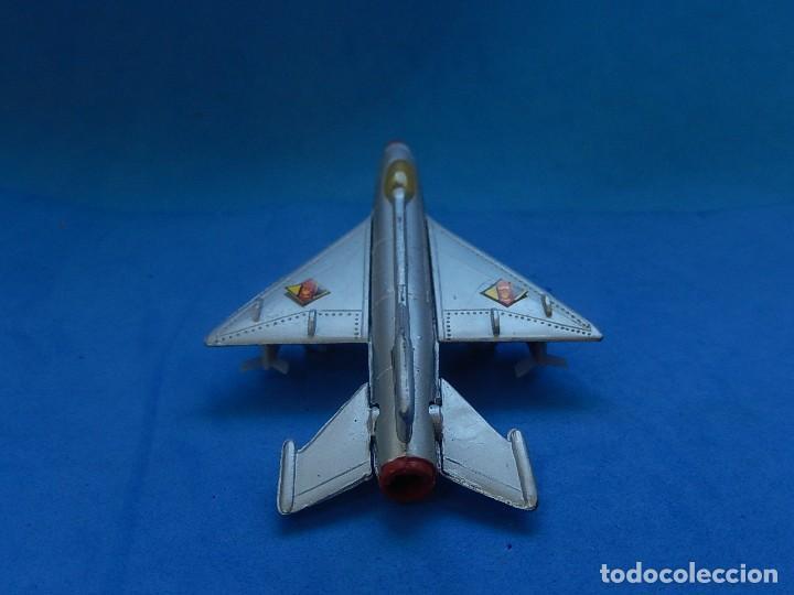 Modelos a escala: Pequeño avión. MIG-21. Fabricado en Hong Kong. - Foto 15 - 129673011