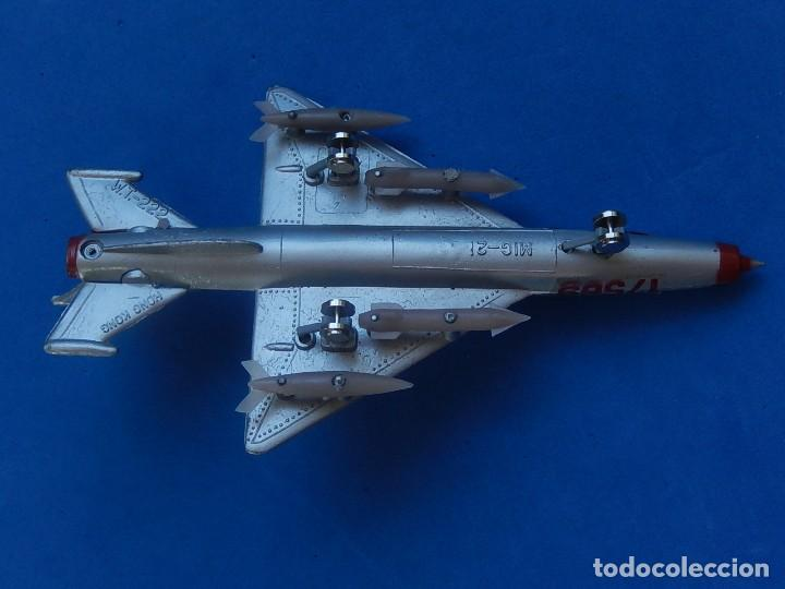 Modelos a escala: Pequeño avión. MIG-21. Fabricado en Hong Kong. - Foto 29 - 129673011