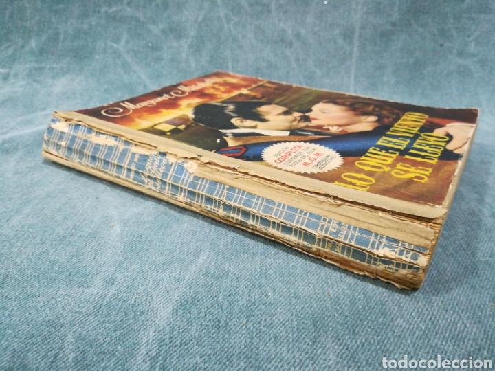 Libros antiguos: LO QUE EL VIENTO SE LLEVÓ - MARGARET MITCHELL - EDICIÓN COMPLETA ILUSTRADA CON FOTOS DEL FILM - 1949 - Foto 4 - 268600984