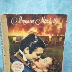 Libros antiguos: LO QUE EL VIENTO SE LLEVÓ - MARGARET MITCHELL - EDICIÓN COMPLETA ILUSTRADA CON FOTOS DEL FILM - 1949. Lote 268600984