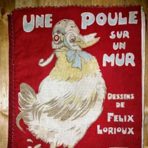 Libro impreso en tela del ilustrador infantil Félix Lorioux Une poule sur un mur dessins F. Lorioux