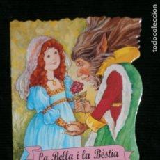 Libros antiguos: F1 CUENTO TROQUELADO LA BELLA I LA BESTIA EDITORIAL COMBEL Nº 16 AÑO 2010 EN CATALAN. Lote 125267455
