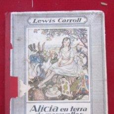 Libros antiguos: ALICIA EN TERRA DE MERAVELLES. LEWIS CARROLL. ED. MENTORA 2ªED. 1930. MAGNIFICA DEDICATORIA. Lote 173925432