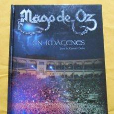 Libros antiguos: MAGO DE OZ EN IMAGENES -LIBRO -CARMEN MOLINA -MEDEA DIFUSION 2009 - METAL. Lote 151490614