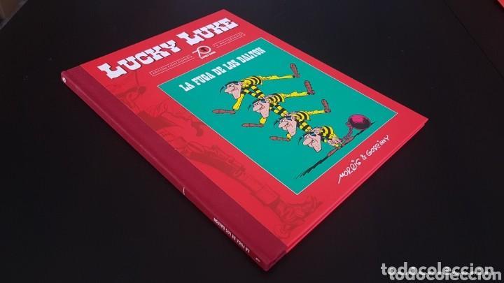 Libros antiguos: Lucky luke 1ª entrega. La fuga de los dalton. Edición coleccionista limitada 70 aniversario. Planeta - Foto 4 - 168323736