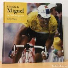 Coleccionismo deportivo: LIBRO DE CICLISMO SOBRE MIGUEL INDURÁIN - LA ESTELA DE MIGUEL EN 101 IMÁGENES, POR CARLOS TIGERO. Lote 180034571