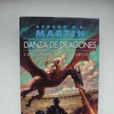 Livres: DANZA DE DRAGONES. CANCIÓN DE HIELO Y FUEGO 5. GEORGE R.R. MARTIN. 1ª EDICIÓN, COMO NUEVO. Lote 241863350