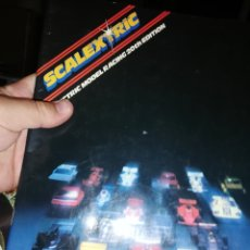Libros: LIBRO DE SCALEXTRIC MODEL RACING 20 TH EDITION. Lote 220669386