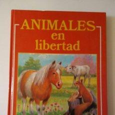 Libros: ANIMALES EN LIBERTAD-COMO NUEVO-HENMA EDICIONES-. Lote 143381508