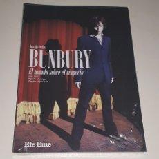 Libros: BUNBURY / LIBRO+MARCA PAGINAS PROMO (PRECINTADO) / EL MUNDO SOBRE EL TRAPECIO. Lote 277722808