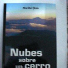 Libros: NUBES SOBRE UN CERRO ANDALUZ. MARIBEL JUAN.. Lote 51040447