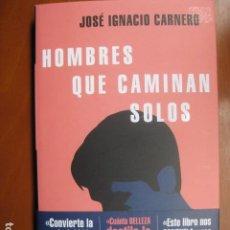 Livros: LIBRO - HOMBRES QUE CAMINAN SOLOS - ED. RANDOM HOUSE - JOSE IGNACIO CARNERO - NUEVO. Lote 263191975