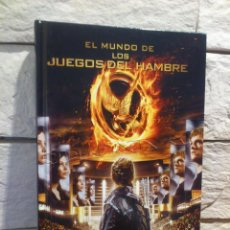 Libros de segunda mano: LOS JUEGOS DEL HAMBRE - HUNGER GAMES - LIBRO OFICIAL - EL MUNDO DE LOS JUEGOS DEL HAMBRE - NUEVO. Lote 102654655